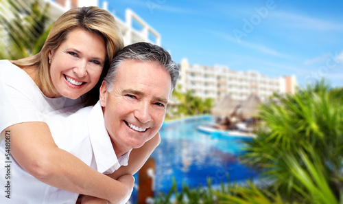 Happy senior couple at tropical resort.