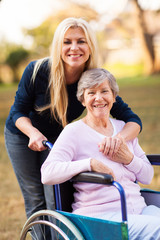 senior woman in a wheelchair and her daugther
