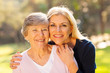 senior woman and middle aged daughter - 54881678