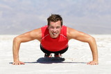 Fitness man doing push ups training outdoor