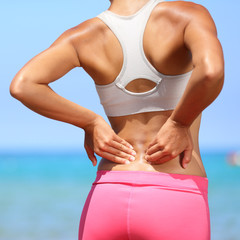 Back pain - woman having injury in lower back
