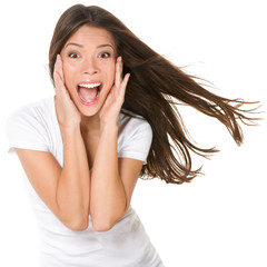 Surprised excited happy screaming woman isolated