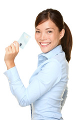 Casual business woman holding showing credit card