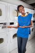 Female Helper Gesturing In Laundry