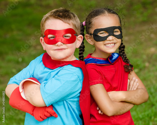 Pretty mixed race girl and boy pretending to be superheroes - 54883882