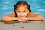Portrait of happy pretty mixed race child by side of pool  - Fine Art prints