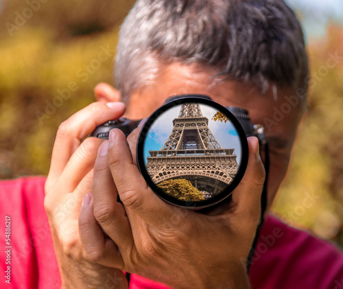 Tourist capturing a shot of Eiffel Tower, Paris