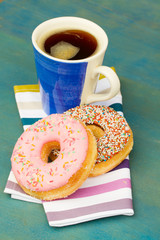 breakfast with fresh black coffee and donuts