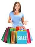 Young happy woman with colorful paper shopping bags isolated