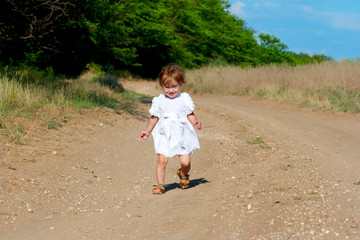 small smile child in the white dress