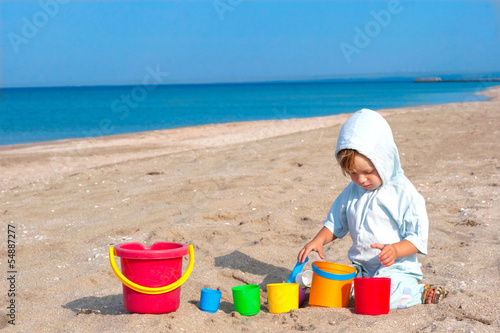 small child play on the beach