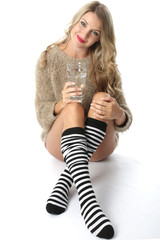 Model Released. Sexy Young Woman Wearing a Jumper and Knee Socks