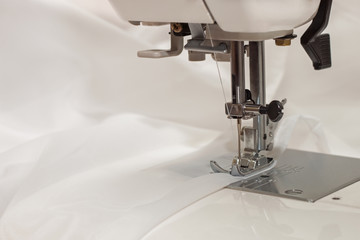 sewing machine and a thin white cloth