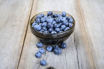 Fresh bilberries on wooden ground
