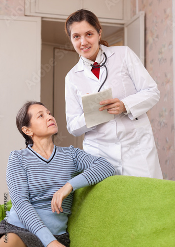 friendly doctor asks mature patient feels