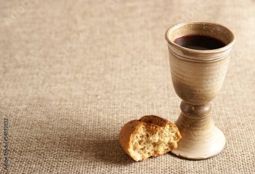 Papiers peints Vin Chalice with wine and bread. Background with copy space