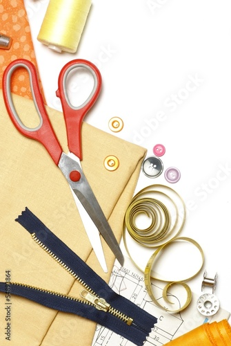 Sewing items on white background with copy space