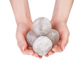 Woman's hands holding round halite rock salt crystals