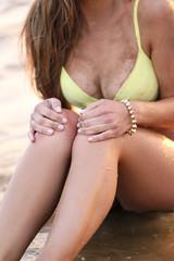 Beautiful girl in bikini near sea