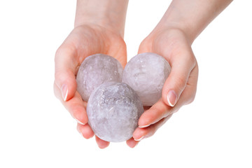Woman's hands holding salt crystals for alternative medicine