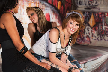 Smiling Teen Sitting with Friends