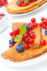 crepes with fresh berries and jam for breakfast, close-up