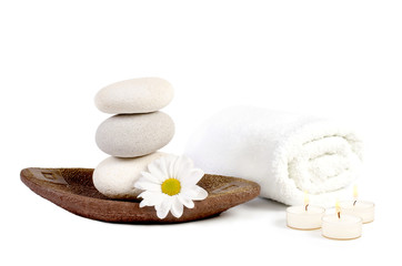spa decoration with stones, daisies and candles