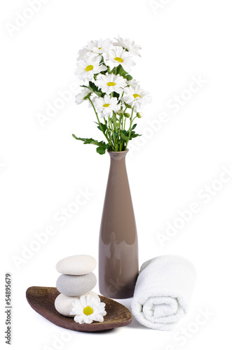 spa decoration with white chrysanthemum flowers and spa stones