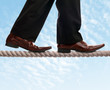Tightrope walker businessman