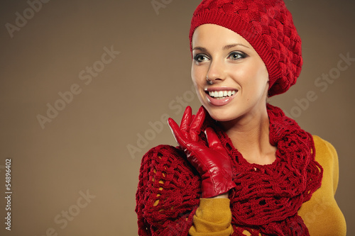 fashionable woman in a autumn color in brown background