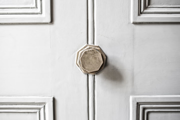 bleached white door with metal knob