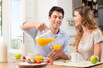 Happy Couple Having Breakfast