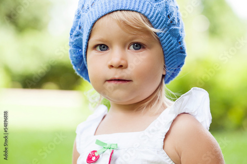 Adorable little girl in a hat