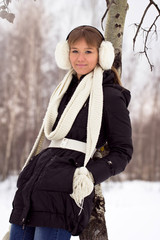 Portrait of a young woman in white knit wool hat and mittens