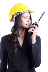female construction worker talking with a walkie talkie