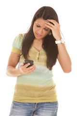 brunette woman frustrated with phone