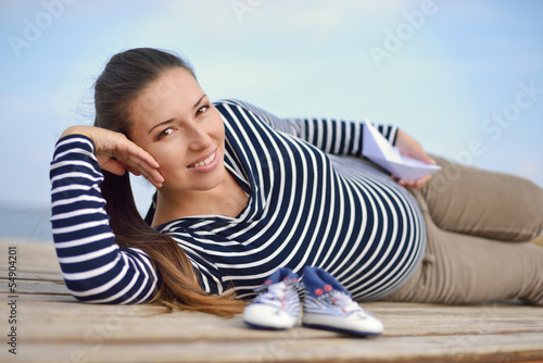 pregnant woman on the sea coast
