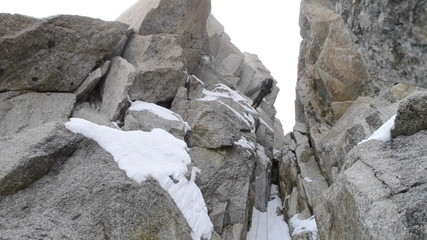Alpine climber abseiling  in winter conditions Chamonix