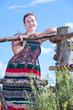 Pretty village girl in sundress against blue sky