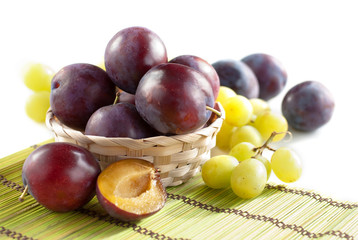 Fresh plums and grapes