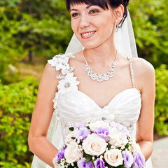 Portrait of a beautiful smiling bride