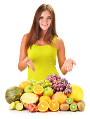 Young woman with assorted fruits isolated on white
