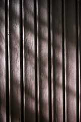 Brown wooden regular planks background or texture