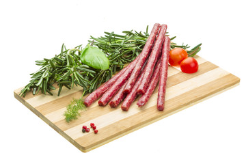 Salami with rosemary, basil and tomato