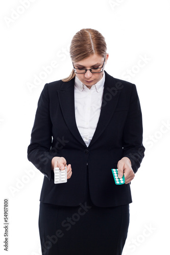 Businesswoman with pills