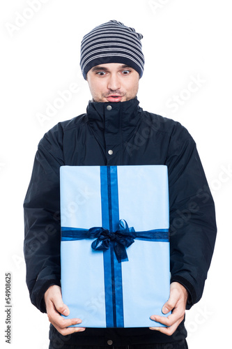 Surprised man with big present