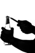 silhouette of a hand holding and opening beer