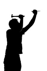 silhouette of a man with a hammer and nail.
