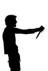 silhouette of a man attempting suicide knife