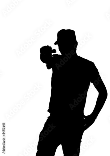 silhouette of a young male pointing gun.